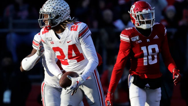 Ohio State cornerback Shaun Wade (24) reacts after making an interception during a 2019 game against Rutgers. Wade declared Monday for the NFL Draft. [Adam Hunger/AP Photo]