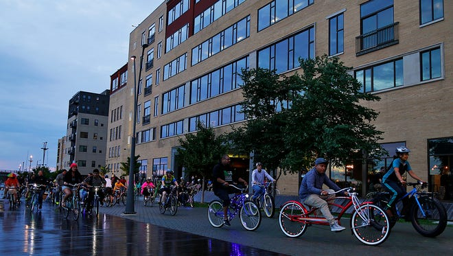 Bicycle enthusiasts ride along the CityDeck during the Critical Mass Green Bay community bike ride in downtown Green Bay on Thursday, July 28, 2016. Over 94 participants went on the ride.