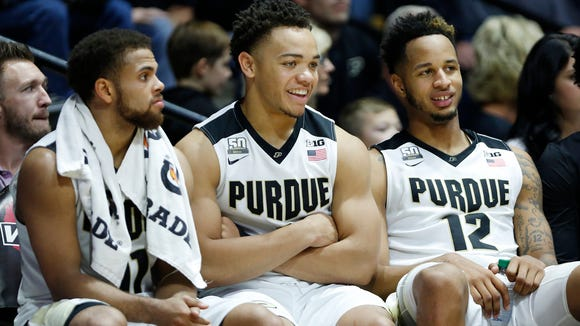 P.J Thompson, from left, Carsen Edwards and Vincent