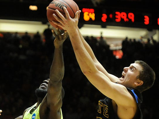 SDSU's Chad White (right) scored 15 points in a loss