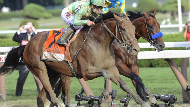 Keen Ice (7), with jockey Javier Castellano, moves past Triple Crown winner American Pharoah, with Victor Espinoza, to win the Travers Stakes horse race at Saratoga Race Course in Saratoga Springs, N.Y., on Saturday.
