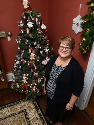 Yolanda Taylor, co-owner, stands inside the reopened White Pillars Christmas House at 7395 East Pike in Zanesville. The shop offers Christmas themed decorations and gifts for sale year round.