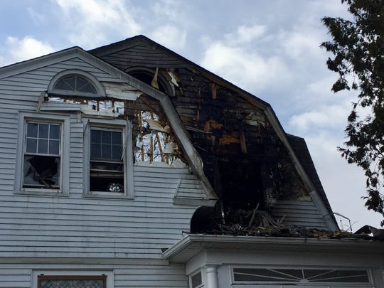 A 61-year-old woman died Tuesday in a Butler house fire.