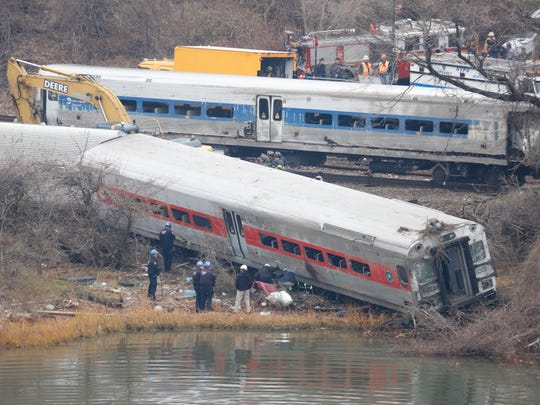 A rail crew works at the scene of the fatal Metro-North train derailment on December 2, 2013 in the Bronx near the Spuyten Duyvil station. The Metro-North passenger train derailed en route to New York City near the Spuyten Duyvil station, killing four people and wounding more than 70 others on December 1, 2013. (Ricky Flores/The Journal News)
