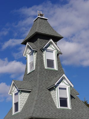 The top two floors of the house, with the chair on the roof.
