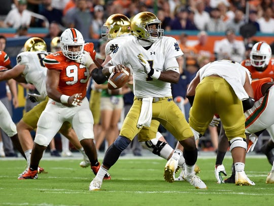 Notre Dame quarterback Brandon Wimbush looks to throws