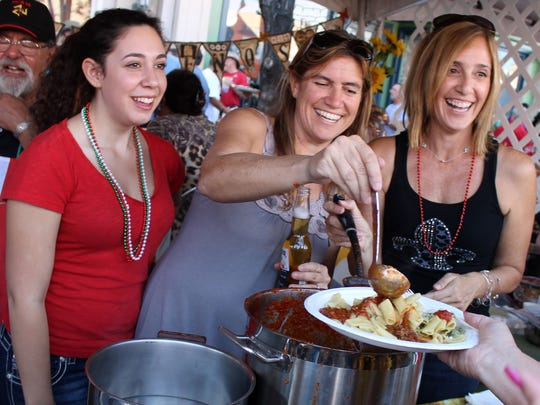 Dishing up sauce at the Eldorado Great Italian Festival in 2014.