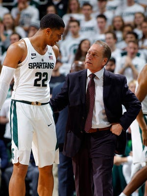 Michigan State coach Tom Izzo talks with Miles Bridges during the first half against Ferris State Thursday, Oct. 26, 2017, in East Lansing, Mich. Michigan State won 80-72.
