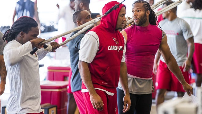 Arizona Cardinals players, including Larry Fitzgerald, right, work out at the Tempe training facility during the off-season strength and conditioning program, Monday, April 18, 2016.