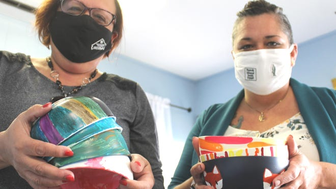 """Kim Hemker and Vanessa Crandall of BCCADSV will serve soup at """"Empty Bowls,"""" noon-6 p.m. Tuesday at Coach Eby Center. Local students helped by decorating bowls for the fundraiser."""