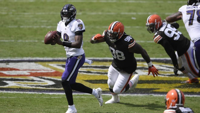 Baltimore Ravens quarterback Lamar Jackson looks to pass as he is pursued by Cleveland Browns defensive tackle Sheldon Richardson during the teams' matchup on Sunday. The Ravens visit the Houston Texans this weekend.