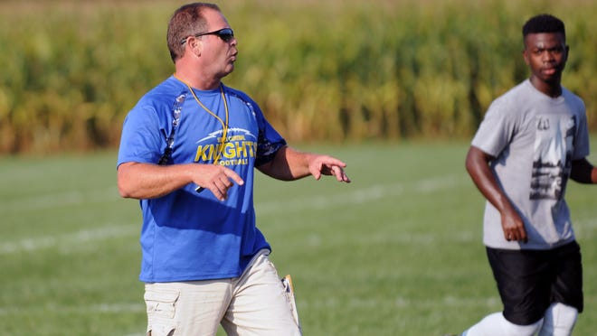 Sussex Central head coach John Wells shouts out orders to players during preseason. This will be Wells' 20th year as head coach.