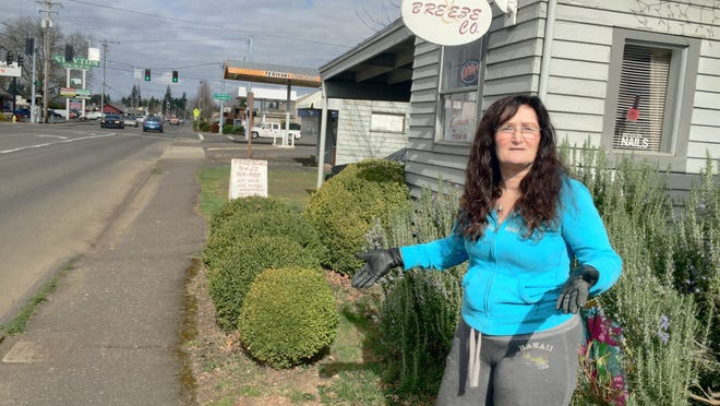 Bre Peterson talks about moving her sandwich board sign to comply with the city code. Peterson operates Breeze & Co, a nail salon on First Avenue in Stayton.