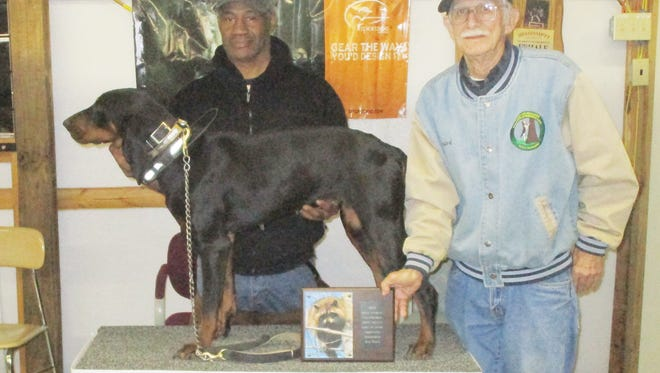 Charles Roberts (left), pictured with Master of Hounds Leonard Burchfield, show off his dog Tamar following a raccoon hunting competition earlier this year.