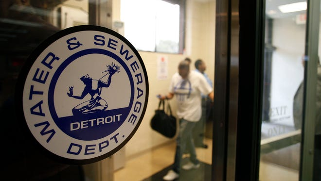 Detroit Water and Sewerage Department logo is displayed on a window as customers attend a Water Affordability Fair August 2, 2014 in Detroit, Michigan. The fair was organized by the Detroit Water and Sewerage Department to help customers who are struggling financially to pay their bills. Thousands of Detroit Water and Sewerage Department customers have had their water disconnected after being delinquent with their bill. (Photo by Joshua Lott/Getty Images)