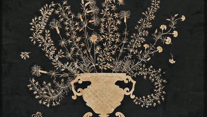 It took a skilled person to cut the tiny branches of flowers in this 18th-century cutwork picture. It is only 12 x 16 inches and sold for $2,460.