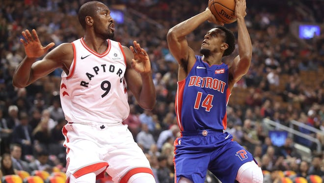 Pistons guard Ish Smith (14) shoots as Raptors forward Serge Ibaka (9) defends during the Pistons' 116-94 exhibition loss on Tuesday, Oct. 10, 2017, in Toronto.