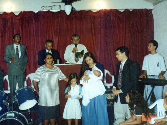 The Pereira family, and some friends, perform in a band at church in Brazil. Rafael is the baby, not yet 1.