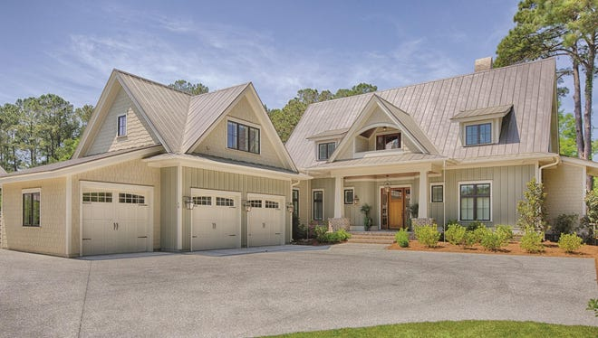 Dormers and a porch add farmhouse-style appeal to the front.