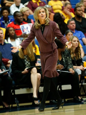 ASU head coach Charli Turner Thorne questions a call by the officials during the second half at of Pac-12 play against Arizona at McKale Center in Tucson, Ariz. February 9, 2014.