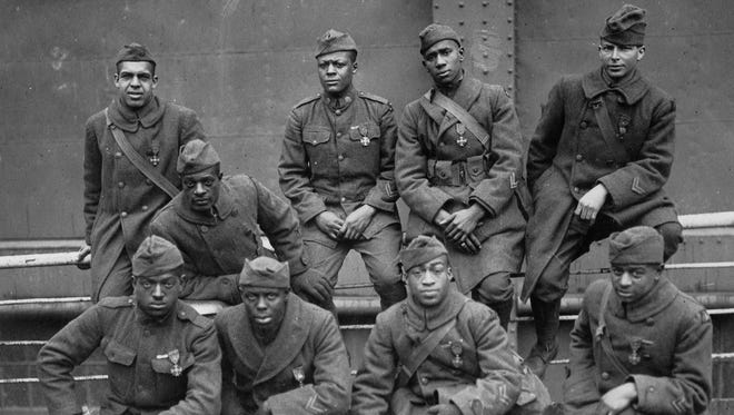 Soldiers of the 369th (15th N.Y.), awarded the Croix de Guerre for gallantry in action, 1919. Left to right. Front row: Pvt. Ed Williams, Herbert Taylor, Pvt. Leon Fraitor, Pvt. Ralph Hawkins. Back Row: Sgt. H. D. Prinas, Sgt. Dan Storms, Pvt. Joe Williams, Pvt. Alfred Hanley and Cpl. T. W. Taylor