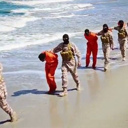 Image from a video released by Islamic State militants on Sunday that appears to show the killing of a group of captured Ethiopian Christians in Libya.