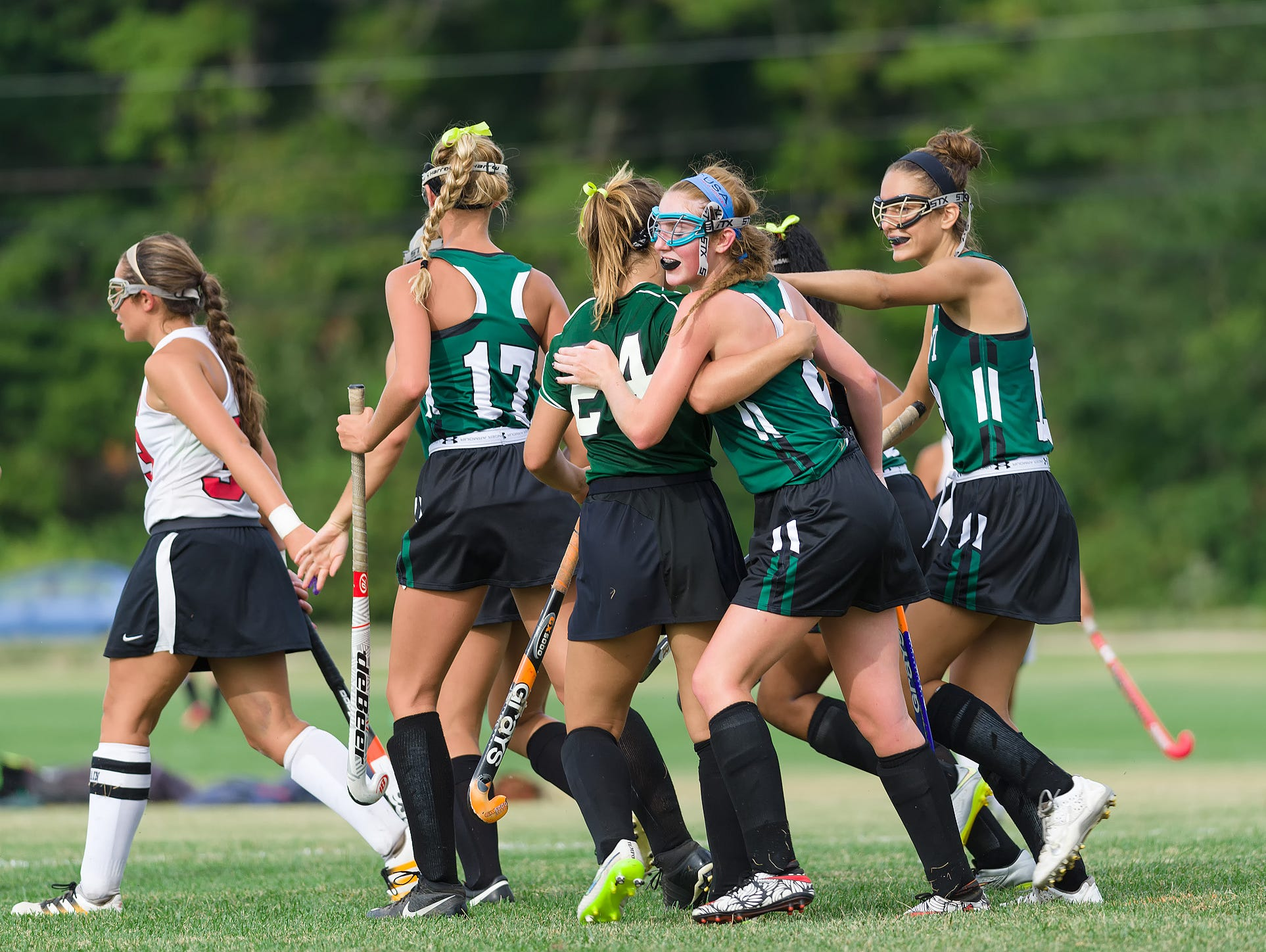 Alexandra Davis (9) of Mt. Pleasant gets congratulated by teammates on her goal in the William Penn vs Mt. Pleasant field hockey game at William Penn on Tuesday.