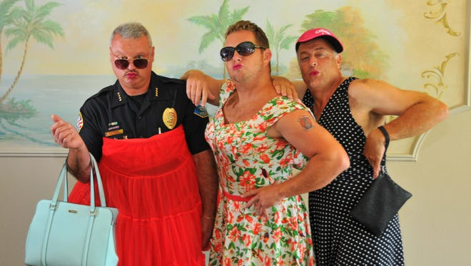 """This motley crew consists of Satellite Beach Police Chief Jeff Pearson, artist Eric LaMarr and Suntree Country Club general manager Steve Lamontagne. The trio will be part of the """"Dude Looks Like a Lady"""" fundraiser for the Women's Center. They all met recently to try on some outfits and try out some makeup with help from Donovan Productions."""