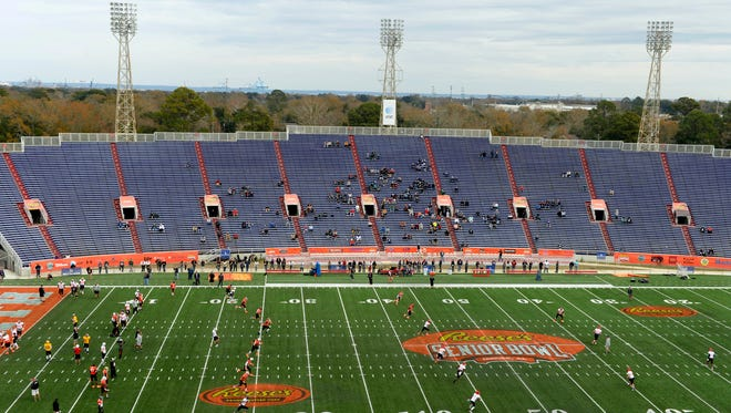 South squad players run through special teams during Senior Bowl practice at Ladd-Peebles Stadium.