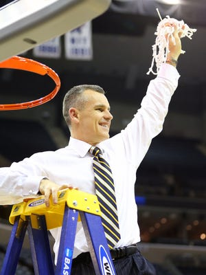 Florida Gators head coach Billy Donovan cuts the net after defeating the Dayton Flyers in the finals of the South Regional.