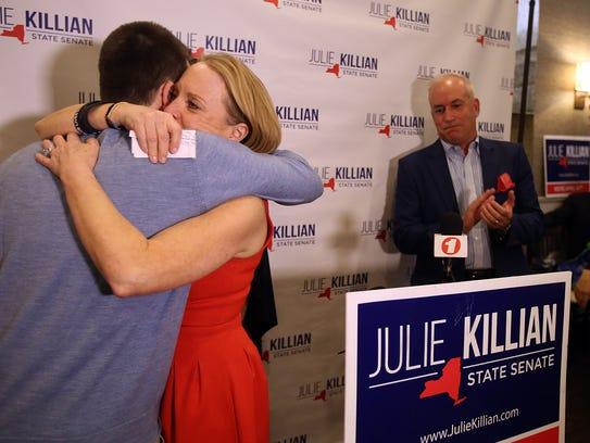 Republican Julie Killian hugs her son after losing