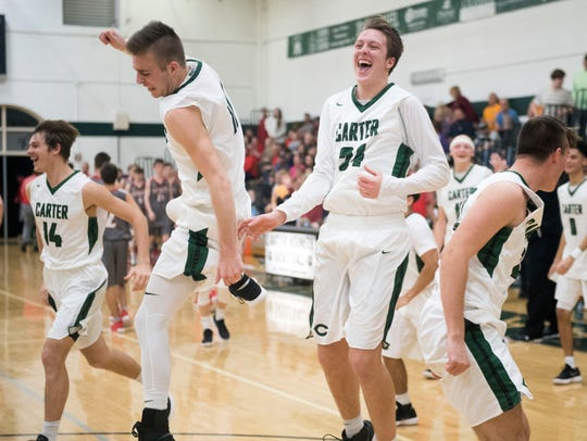 Adam Hurd, left, and Parker McNew celebrate their 81-54