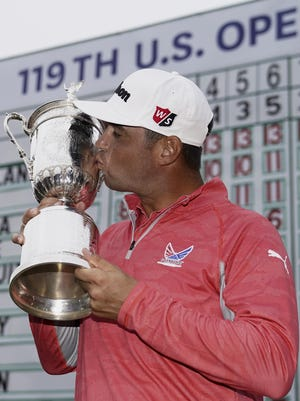 Gary Woodland posses with the trophy after winning the U.S. Open Championship golf tournament Sunday, June 16, 2019, in Pebble Beach, Calif.