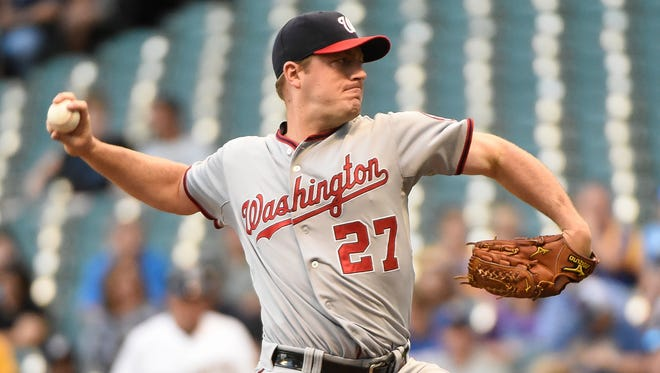 Jun 24, 2014; Milwaukee, WI, USA;  Washington Nationals pitcher Jordan Zimmermann (27) pitches in the first inning against the Milwaukee Brewers at Miller Park. Mandatory Credit: Benny Sieu-USA TODAY Sports