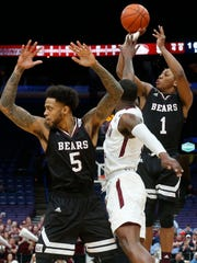 Mustafa Lawrence (1) puts up a shot during Missouri State's quarterfinal game against Southern Illinois in the MVC Tournament at the Scottrade Center on Friday, March 2, 2018 in St. Louis, MO.