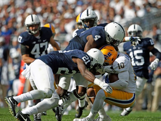 Cornerback Amani Oruwayne (21) has been the play maker, but Penn State needs Nick Scott (4) to be an enforce at safety.