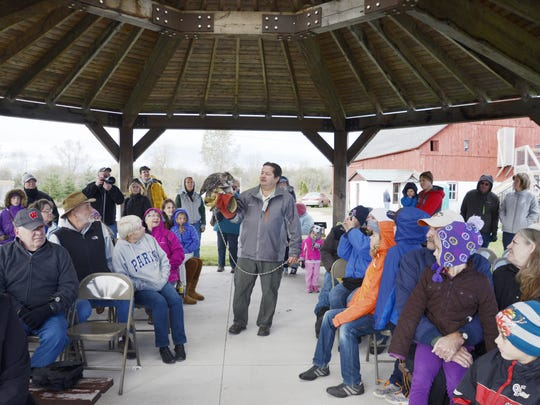 Wildlife of Wisconsin volunteer Jerry Theys brings a great horned owl closer to the participants during an educational presentation at the Owl Fest at Woodland Dunes Nature Center and Preserve on Saturday, Oct. 17, 2015 in Two Rivers. Volunteers of Wildlife of Wisconsin bring a turkey vulture, a barn owl, a red-tailed hawk, a barred owl, a screech owl and a great horned owl for an educational presentation.