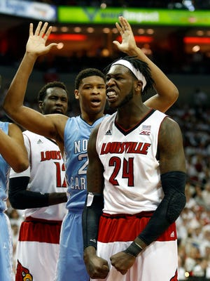 Louisville's Montrezl Harrell gets the bucket and the and one against North Carolina's Taylor Ford. 