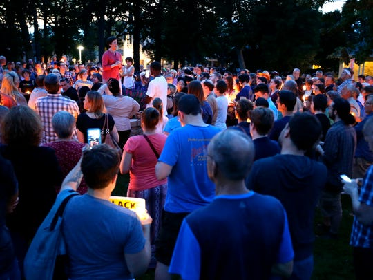 A crowd gathers for a candlelight vigil to show support for Charlottesville, Virginia Sunday at City Park in Appleton. The event was hosted by FAWN Fox Valley.