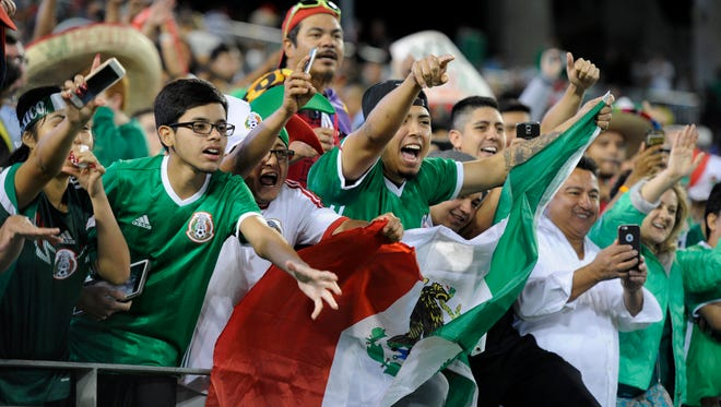 Mexican fans celebrate their team's 2-1 victory over New Zealand at Nissan Stadium Saturday, Oct. 8, 2016, in Nashville, Tenn.