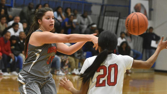Westmoreland's Karley Smith passes as Pearl-Cohn's Shanice Nelson defends during Monday's Region 5-AA Tournament semifinals.