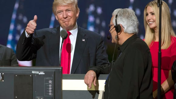 Republican presidential candidate Donald Trump, center,
