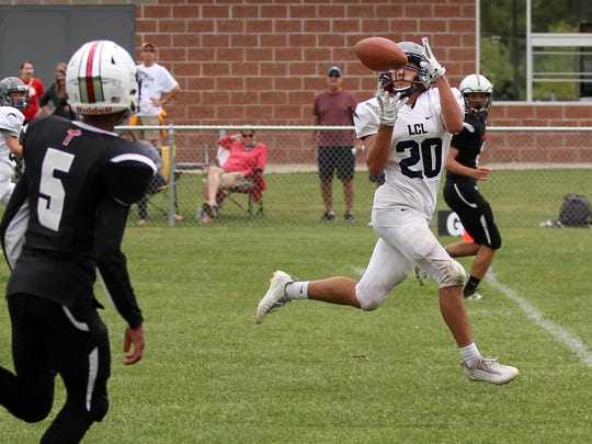 Michael Schumacher catches a pass for Lake Country Lutheran earlier this year. The receiver has been emblematic of what makes LCL the program it is today -- players who stick it out for four years and evolve into contributors.