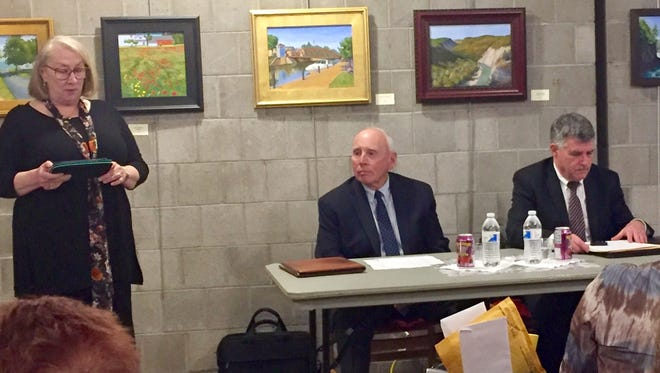 Mary Hussong-Kallen, president of the Rochester Metropolitan Area League of Women Voters, introduces Monroe County Election Commissioners David Van Varick and Tom Ferrarese on Wednesday before a league meeting Wednesday.
