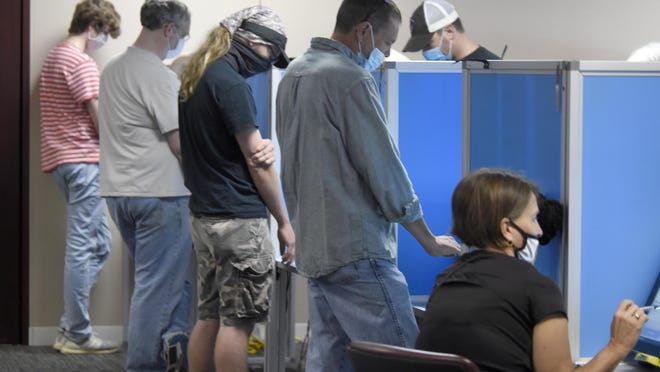 People cast their ballots during advance voting at the Columbia County government complex in Evans, Ga., Friday afternoon October 16, 2020