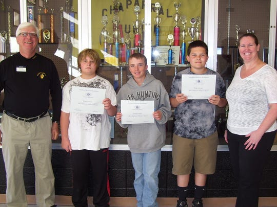 Chaparral Middle School, pictured from left to right, is Kiwanis member Ned Kline, students Wyatt Lawton, Conner Carrell and Dylan Moroni, and CMS Principal Robi Coker.