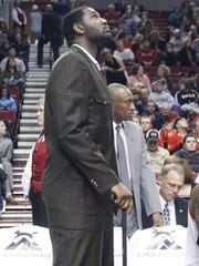 Portland Trail Blazers' Greg Oden stands with his cane during an NBA basketball game with the Minnesota Timberwolves Monday, Jan. 17, 2011, in Portland, Ore.