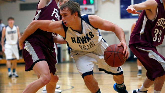 Sam Burkart of Xavier tries to get around the Fox Valley Lutheran defense during an Eastern Valley Conference boys' basketball game Dec. 18 in Appleton.