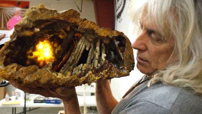 Rick Schwardt, of Florida, shines a light source through the back of this petrified agatized coral geode to show the brilliant cavern-like beauty of his findings in the rivers of northern Florida. Schwardt was here for the 50th annual Rockhound Roundup in 2015. This year's annual event hosted by the Deming Gem & Mineral Society begins Thursday at the Southwestern New Mexico State Fairgrounds. The Roundup will run through Sunday.