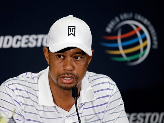 Tiger Woods answers questions at his news conference during the final practice day for the Bridgestone Invitational golf tournament Wednesday, July 30, 2014, in Akron, Ohio. (AP Photo/Mark Duncan)